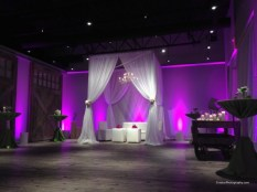 Sweetheart table cabana and uplighting